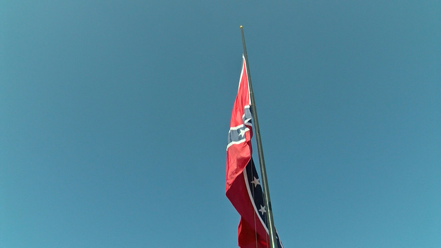Largest Confederate Battle flag flies near Danville